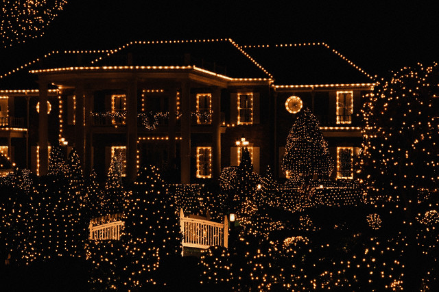House illuminated by christmas lights --- Image by © Image Source/Corbis