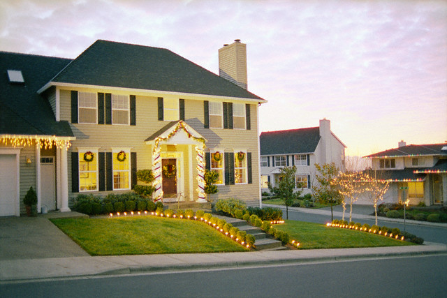 Christmas Lights Decorating Houses at Sunset --- Image by © David Papazian/Corbis