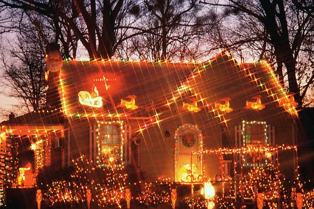 House Aglow with Christmas Lights --- Image by © John Aikins/Corbis