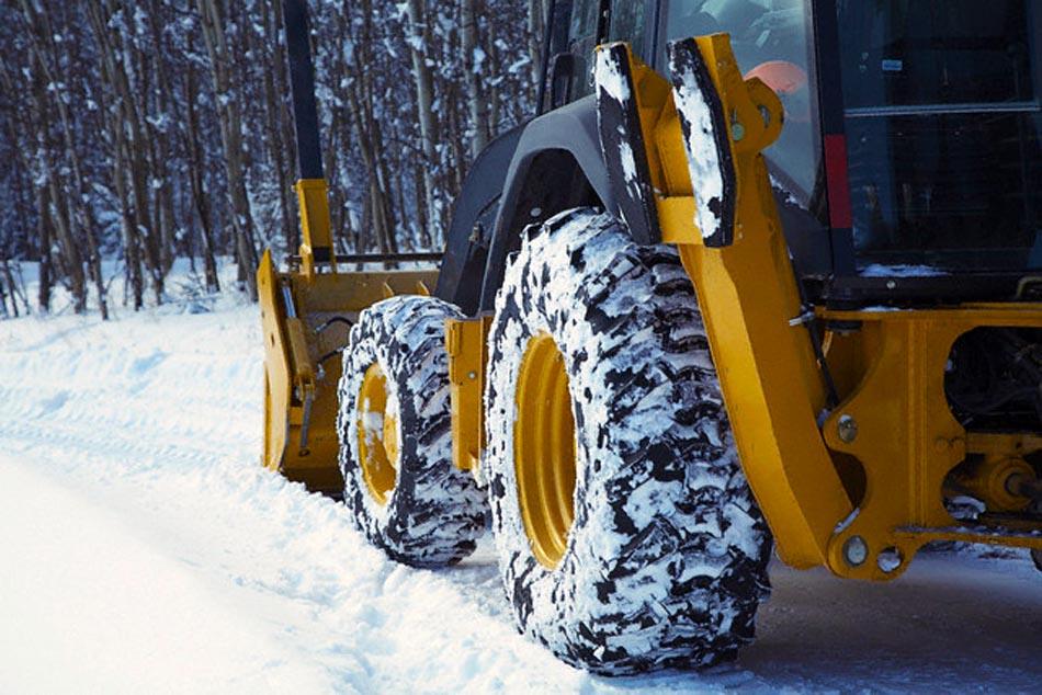 Bulldozer clearing snow --- Image by © Marnie Burkhart/Corbis